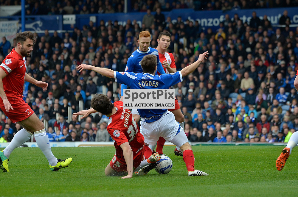 Wes Fogden winning Portsmouth's early penalty, Portsmouth v Hartlepool, Skybet League Two, 5th April 2014. (c) Michael Hulf | SportPix.org.uk