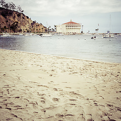 Catalina Island beach and Casino picture. Catalina Casino is a historic theatre built in the early 1900s. Catalina Island is a popular travel destination off the coast of Southern California in the United States.