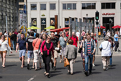 View of pedestrians crossing street at Potsdamer Platz in Berlin Germany