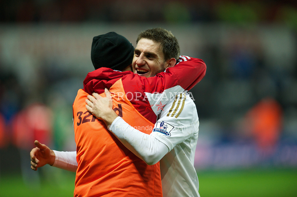 SWANSEA, WALES - Wednesday, January 23, 2013: Swansea City's Angel Rangel celebrates after beating Chelsea during the Football League Cup Semi-Final 2nd Leg match at the Liberty Stadium. (Pic by David Rawcliffe/Propaganda)