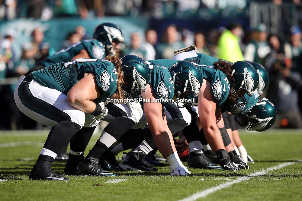 The Philadelphia Eagles special teams punt team gets set to snap the ball while warming up before the 2015 week 10 regular season NFL football game against the Miami Dolphins on Sunday, Nov. 15, 2015 in Philadelphia. The Dolphins won the game 20-19. (©Paul Anthony Spinelli)