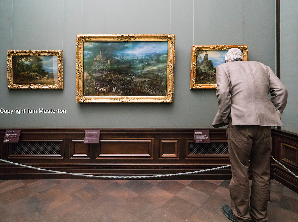 Visitor looking at paintings at Gemäldegalerie Alte Meister or Zwinger Museum in Dresden, Germany .Editorial Use Only.