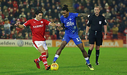 Ivan Toney of Peterborough United in action with Kenny Dougall of Barnsley - Mandatory by-line: Joe Dent/JMP - 26/12/2018 - FOOTBALL - Oakwell Stadium - Barnsley, England - Barnsley v Peterborough United - Sky Bet League One