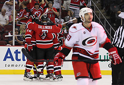 Oct 10; Newark, NJ, USA; The New Jersey Devils celebrate a goal by New Jersey Devils defenseman Mark Fayne (29) during the second period at the Prudential Center.