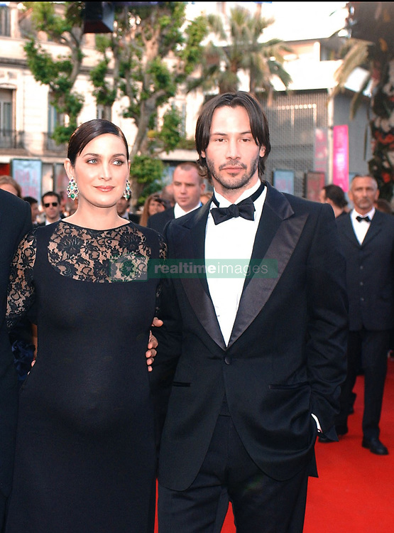 ©Arnal-Hahn-Nebinger/ABACA. 45645-18. Cannes-France, 15/05/2003. Cast members Hugo Weaving, Carrie-Anne Moss and Keanu Reeves arrive at the screening of the film Matrix Reloaded in the Palais des Festivals as part of the 56th Cannes Film Festival.  Cannes Film Festival Festival de Cannes Festival du Film de Cannes Cannes Film Festival Matrix Reloaded Matrix 2 The Matrix Reloaded Moss Carrie-Anne Moss Carrie-Anne Reeves Keanu Reeves Keanu Weaving Hugo Weaving Hugo Montee des marches Tapis rouge Red carpet Presentation de film Presentation de serie Movie Screening<br /> Photocall<br /> Photo call Soiree Party Cannes France Frankreich Provence-Alpes-Côte d'Azur Provence-Alpes-Cote d'Azur Horizontal Landscape Plan americain Half length    45645_18