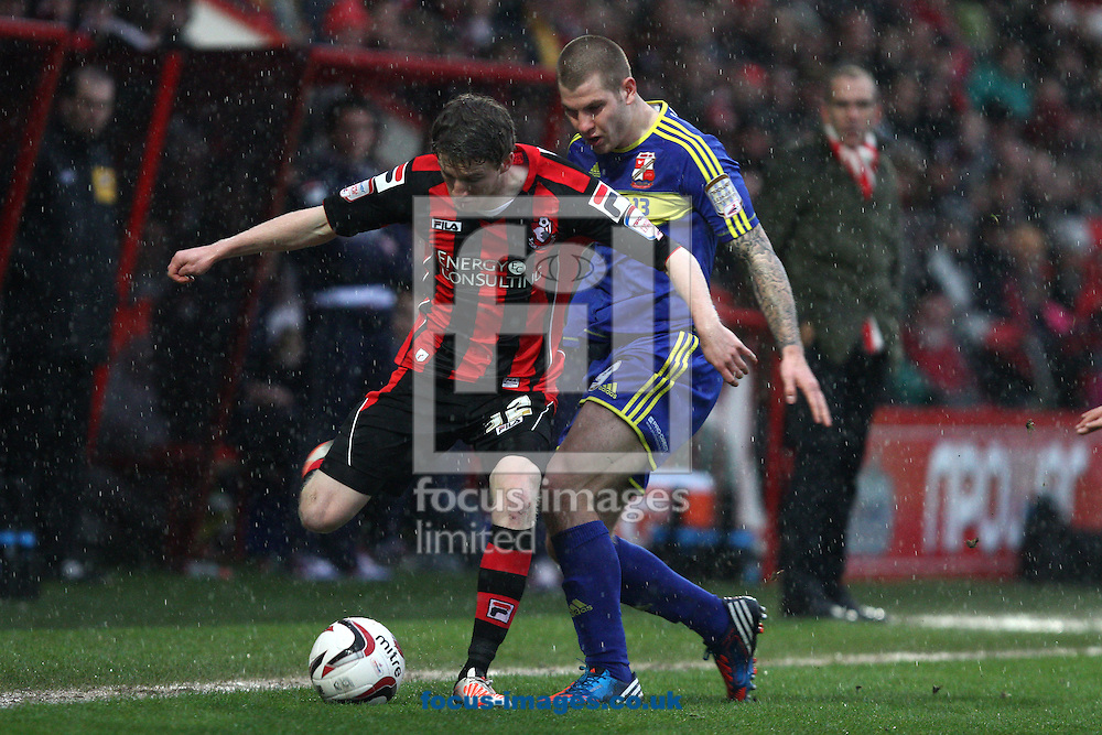 Picture by Daniel Chesterton/Focus Images Ltd +44 7966 018899.12/01/2013.Eunan O'Kane of Bournemouth and James Collins of Swindon Town during the npower League 1 match at the Seward Stadium, Bournemouth.
