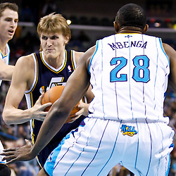December 17, 2010; New Orleans, LA, USA; Utah Jazz small forward Andrei Kirilenko (47) drives between New Orleans Hornets small forward Trevor Ariza (1) and center D.J. Mbenga (28) during the first half at the New Orleans Arena.  Mandatory Credit: Derick E. Hingle