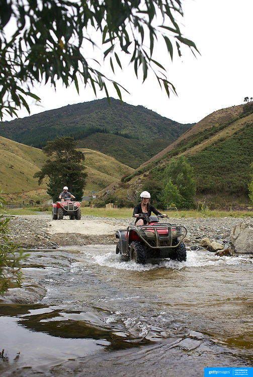 Tourist young and old Quad biking at Happy Valley Adventures, Cable Bay Road. Nelson, South Island, New Zealand. 30th January  2011, Photo Tim Clayton.