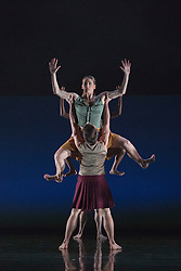 """© Licensed to London News Pictures. 18/11/2014. London, England. Lucy Balfour at the top performing Terra Incognita choreographed by Shobana Jeyasingh. British dance company """"Rambert"""" perform their new show """"Triptych"""" at Sadler's Wells Theatre from 18 to 22 November 2014. Choreographed by Shobana Jeyasingh with Luke Ahmet, Lucy Balfour, Adam Blyde, Carolyn Bolton, Simone Damberg Würtz, Dane Hurt, Vanessa King, Adam Park, Hannah Rudd and Pierre Tappon dancing. Photo credit: Bettina Strenske/LNP"""