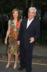 SIMON & JOYCE REUBEN at Sir David & Lady Carina Frost's annual summer party held in Carlyle Square, Chelsea, London on 5th July 2006.<br /><br />NON EXCLUSIVE - WORLD RIGHTS