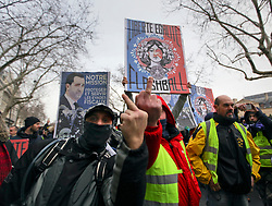 19 January 2019. Paris, France.<br /> Gilets Jaunes - Acte X take to the streets of Paris. Flicking the bird to the media. An estimated 7,000 people took part in the looping 14 km route from Place des Invalides to protest tax hikes from the Government of Emmanuel Macron imposed on the people. An estimated 80,000 people took part in protests across the country. Regrettably the movement has attracted a violent element of agitators who often face off with riot police at the end of the marches which tends to deflect attention away from the message of the vast majority of peaceful protesters.<br /> Photo&copy;; Charlie Varley/varleypix.com