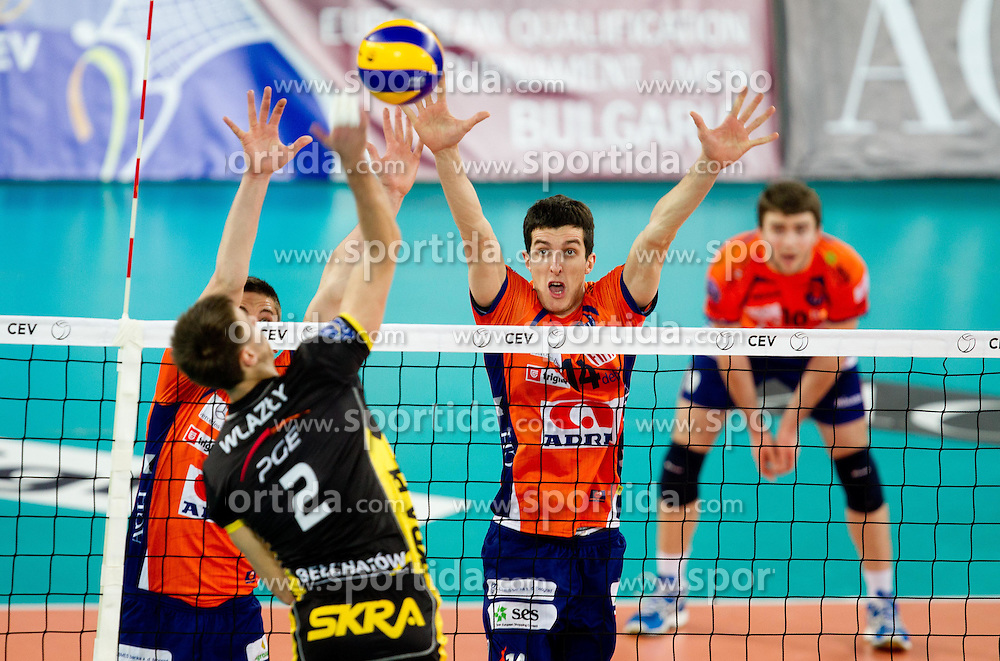 Andrej Flajs and Milan Rasic of ACH vs Mariusz Wlazly of Belchatow during volleyball match between ACH Volley LJUBLJANA and  PGE Skra Belchatow (POL) of 2012 CEV Volleyball Champions League, Men, League Round in Pool F, 4th Leg, on December 20, 2011, in Arena Stozice, Ljubljana, Slovenia. (Photo By Vid Ponikvar / Sportida.com)