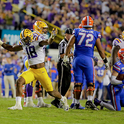 Oct 12, 2019; Baton Rouge, LA, USA; LSU Tigers linebacker K'Lavon Chaisson (18) celebrates after sacking Florida Gators quarterback Kyle Trask (11) during the fourth quarter at Tiger Stadium. Mandatory Credit: Derick E. Hingle-USA TODAY Sports