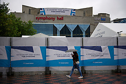 © Licensed to London News Pictures. 01/10/2016. Birmingham, UK. A security fence surrounding the conference venue, covered din Conservative Party branding. Heightened police and security presence around the ICC in Birmingham City centre ahead of the  Conservative Party Conference which starts tomorrow (Sun). Photo credit: Ben Cawthra/LNP