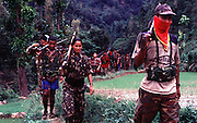 Mid-western Nepal, Maoist army move through Jajarkot district. Despite primitive weapons they have swept over the area and their ambushes render it a no-go area for the local Nepalese police. 1:5  fighters are women<br />