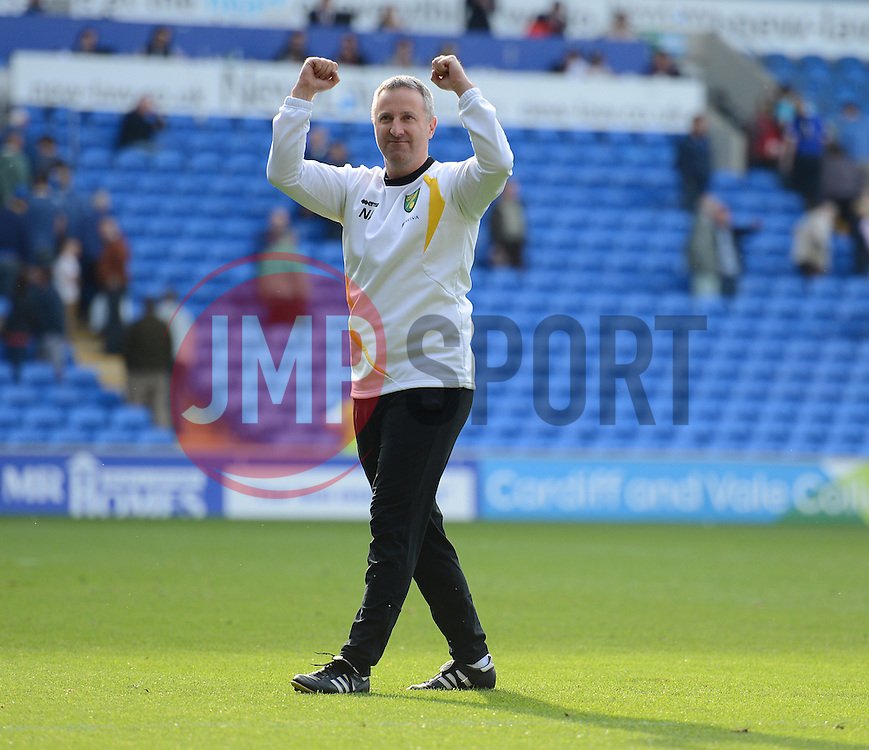 Norwich Manager, Neil Adams celebrates there win over cardiff. - Photo mandatory by-line: Alex James/JMP - Mobile: 07966 386802 30/08/2014 - SPORT - FOOTBALL - Cardiff - Cardiff City stadium - Cardiff City  v Norwich City - Barclays Premier League