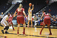 """Ole Miss guard Gracie Frizzell (12) makes a three pointer against Alabama at the C.M. """"Tad"""" Smith Coliseum in Oxford, Miss. on Sunday, January 11, 2015. Frizzell led all scorers with a career-high 24 points, made eight 3-pointers, the most by a Southeastern Conference player this season and the most in a single game in program history."""