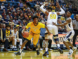 Nov 24, 2018; Morgantown, WV, USA; Valparaiso Crusaders guard Bakari Evelyn (4) drives past West Virginia Mountaineers forward Sagaba Konate (50) during the first half at WVU Coliseum. Mandatory Credit: Ben Queen-USA TODAY Sports