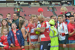 28-07-18 Emirates Airline Park, Johannesburg. Super Rugby semi-final Emirates Lions vs NSW Waratahs. outside centre Lionel Mapoe signs a rugby ball for a fan<br />  Picture: Karen Sandison/African News Agency (ANA)