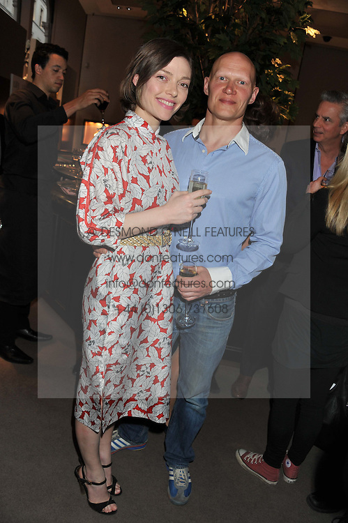CAMILLA RUTHERFORD and DOMINIC BURNS at the launch party for Spectator Life hosted by Andrew Neil at Asprey, 167 New Bond Street, London on 28th March 2012.
