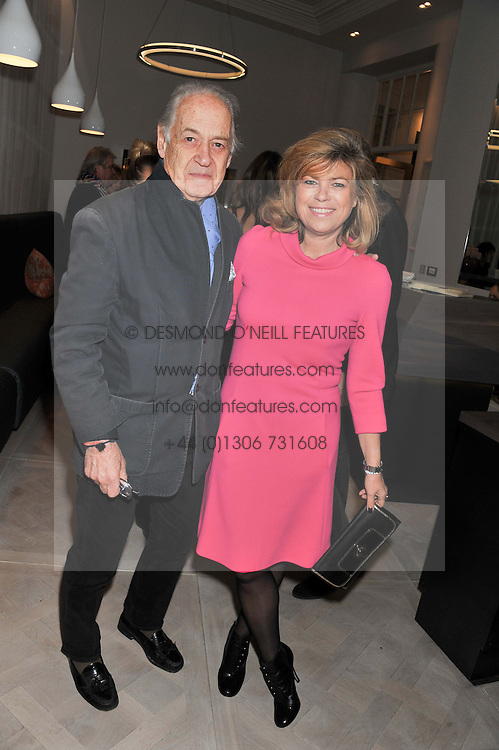 JOHN & SARAH STANDING at a party to celebrate the publication of Fame Game by Louise Fennell held at Grace, West Halkin Street, London on 12th March 2013.