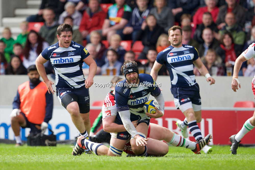 25.04.2015.  Sale, England.  Aviva Premiership Rugby. Sale Sharks versus Harlequins. Sale Sharks lock Andrei Ostrikov is tackled.