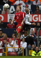 Fotball<br /> VM-kvalifisering<br /> 09.10.2004<br /> Foto: BPI/Digitalsport<br /> NORWAY ONLY<br /> <br /> England v Wales<br /> <br /> An off balance David Beckham goes up with Ben Thatcher and feels his elbow in the ribs which leads to the injury to the England captain