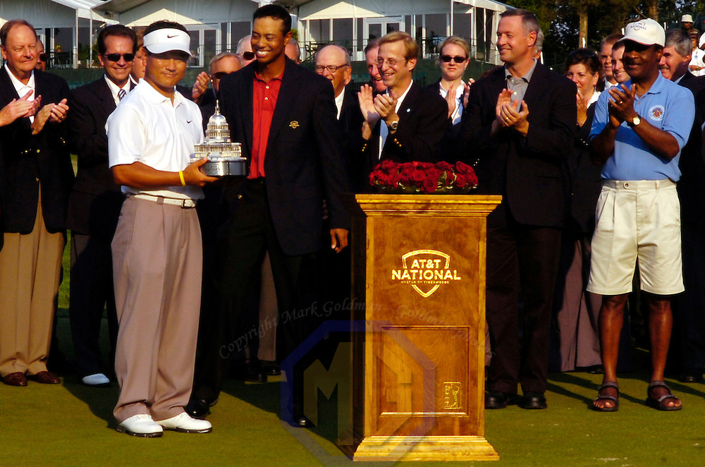 08 July 2007:  K. J. Choi (L) is presented with the winning trophy by Tiger Woods (C) after winning the inaugural AT&T National PGA event championship at Congressional Country Club in Bethesda, Md. as Maryland Governor, Martin O'Malley (R) looks on.  K. J. Choi won the tournament with a 9 under par score of 271.  ****For Editorial Use Only****