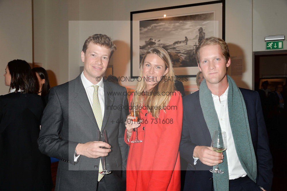 Left to right, EDMUND & ABI SALVESEN and EARL PERCY at a private view of photographs by renowned wildlife photographer David Yarrow in aid of TUSK entitled 'Wild Encounters' held at Somerset House on 19th September 2016.