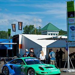 July 6, 2012 - The Team Falken Tire Porsche 911 GT3 RSR driven by Wolf Henzler and Bryan Sellers drive through the paddock during the American Le Mans Northeast Grand Prix weekend at Lime Rock Park in Lakeville, Conn.
