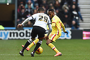 MK Dons forward Rob Hall battles with Derby County defender Marcus Olsson during the Sky Bet Championship match between Derby County and Milton Keynes Dons at the iPro Stadium, Derby, England on 13 February 2016. Photo by Jon Hobley.