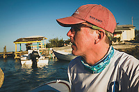 Brian White heads back to the Grand Illusion II after a visit to Little Farmer's Cay, Exumas, Bahamas.