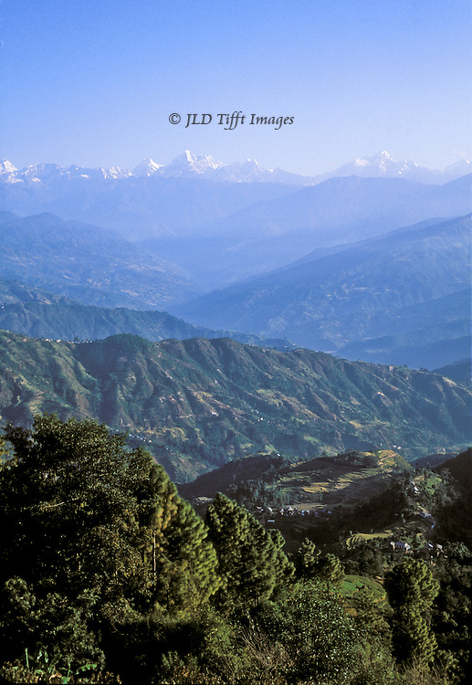 Scenic view across hilly farmland to the Lantang Himal, from the resort town of Nagarkot in the  eastern Kathmandu valley.