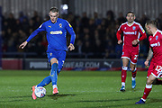 AFC Wimbledon striker Joe Pigott (39) dribbling and about to take on Gillingham defender Barry Fuller (12) during the EFL Sky Bet League 1 match between AFC Wimbledon and Gillingham at the Cherry Red Records Stadium, Kingston, England on 23 November 2019.