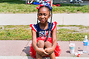 Girl with braids at the Fourth of July parade in Ames, Iowa
