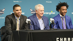 June 22, 2018 - Charlotte, NC, USA - Charlotte Hornets first and second round draft picks Miles Bridges, left, and Devonte' Graham, right, sit with President of Basketball Operations & General Manager Mitch Kupchak during their introductory news conference at Spectrum Center in Charlotte, N.C., on Friday, June 22, 2018. (Credit Image: © David T. Foster Iii/TNS via ZUMA Wire)