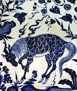 Dish with under glaze blue decoration of a kylin horned creature, Jingdezhen kilns, Jangxi province, 1350-1400.