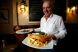 UK ENGLAND BERKSHIRE BUCKLEBURY 22MAR11 - John Hayley (age withheld) serves Fish & Chips and Linguini with roasted cherry tomatoes at his pub, The Old Boot Inn at Stanford Dingley in Berkshire, England. Kate Middleton and Prince William are regular patrons to his pub and Mr Hayley has been invited to the Royal Wedding on the 29th of April 2011...jre/Photo by Jiri Rezac..© Jiri Rezac 2011