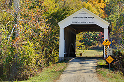 2006 May 08:   Parke County Indiana is the site of the Indiana Covered Bridge Festival every October.  This is the Bowsher Ford Bridge.  It was built over Mill Creek on Bowsher Road in 1915 by Eugene Britton. This bridge has a 72' span.<br /> <br /> This image was produced in part utilizing High Dynamic Range (HDR) processes.  It should not be used editorially without being listed as an illustration or with a disclaimer.  It may or may not be an accurate representation of the scene as originally photographed and the finished image is the creation of the photographer.
