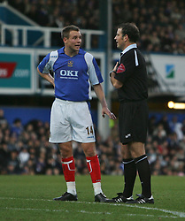 PORTSMOUTH, ENGLAND - SATURDAY, DECEMBER 9th, 2006: Matthew Taylor of Portsmouth chats with referee Mark Clattenburg during the Premiership match at Fratton Park. (Pic by Chris Ratcliffe/Propaganda)