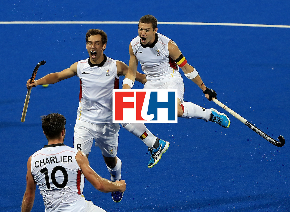 RIO DE JANEIRO, BRAZIL - AUGUST 16:  John-John Dohmen #7, Florent Van Aubel #8, and Cedric Charlier #10 of Belgium celebrate a goal against the Netherlands during a semifinal match on Day 11 of the Rio 2016 Olympic Games at the Olympic Hockey Centre on August 16, 2016 in Rio de Janeiro, Brazil.  (Photo by Sam Greenwood/Getty Images)