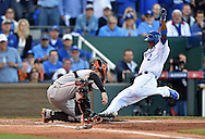 Oct 15, 2014; Kansas City, MO, USA; Kansas City Royals shortstop Alcides Escobar (2) scores a run as the ball gets away from Baltimore Orioles catcher Caleb Joseph (left) during the first inning in game four of the 2014 ALCS playoff baseball game at Kauffman Stadium. Mandatory Credit: Peter G. Aiken-USA TODAY Sports