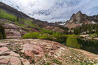 Sundial Peak near Lake Blanche in Big Cottonwood Canyon is part of the Wasatch Mountains near Salt Lake City. An early morning storm clears up to provide a grand landscape only minutes away from the city.