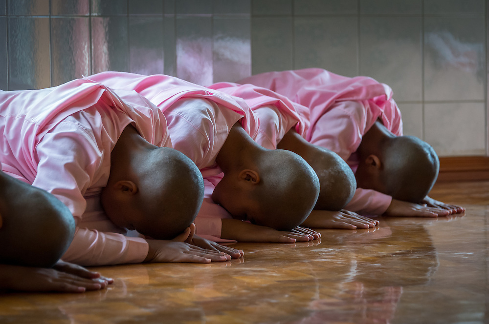 MANDALAY, MYANMAR - CIRCA DECEMBER 2013: Nuns meditating in a monastery close to Mandalay in Myanmar