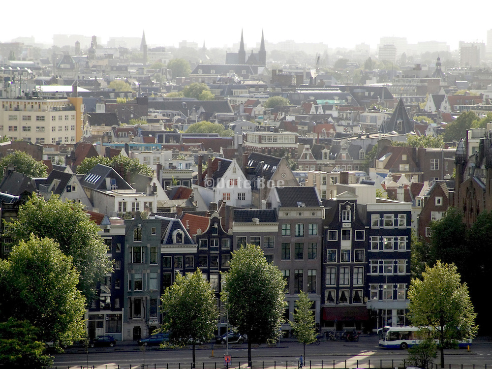 overview of Amsterdam with typical Dutch canal houses in foreground