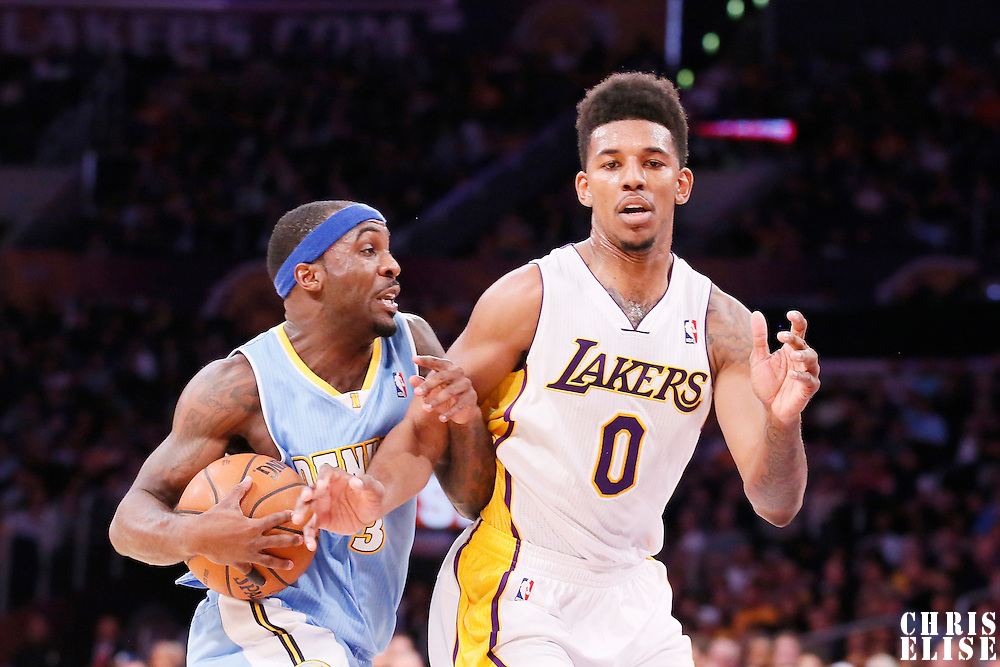 05 January 2014: Denver Nuggets point guard Ty Lawson (3) drives past Los Angeles Lakers small forward Nick Young (0) during the Denver Nuggets  137-115 victory over the Los Angeles Lakers at the Staples Center, Los Angeles, California, USA.