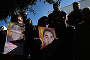 The Family of Majdi Mnassri, 25 years old, killed in January 12 by the police in Citè Ettdhaman, a neighborhood of Tunis, show his image during a demonstration under the building of governement demanding the dissolution of the new interim governement.