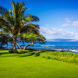 Wailea Makena Maui Hawaii photo with a palm tree, outrigger canoe and <br /> Kaho'olawe Island along the Pacific Ocean. Copyright ⓒ 2019 Paul Velgos with All Rights Reserved.