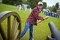 JEROME A. POLLOS/Press..Nic Steiner, 14, finishes dry swabbing a cannon before loading it during a class Wednesday at Lakes Magnet Middle School. Students learned the proper procedures to loading and fire artillery represented by an air-powered cannon.