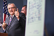 17 JULY 2012 - PHOENIX, AZ: MIKE ZULLO (center), the Sheriff's volunteer investigator, and Maricopa County Sheriff JOE ARPAIO (left) at the announcement that President Obama's birth certificate is not authentic. Arpaio said his investigation proves that the long form birth certificate President Barrack Obama has used to prove his citizenship is a fraud. He also said that Hawaii's lax standards for getting a birth certificate may pose a serious flaw to the United States' national security. PHOTO BY JACK KURTZ